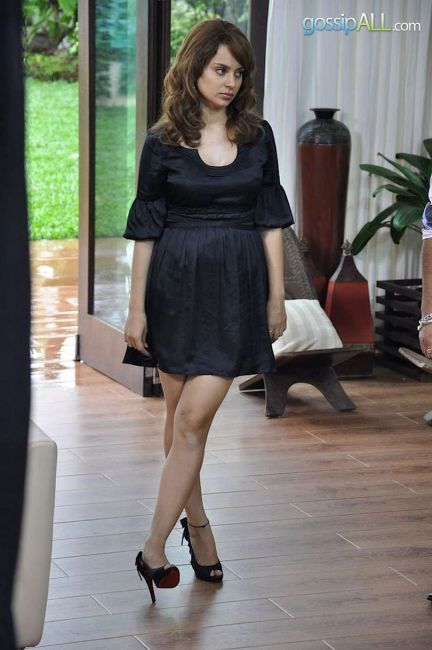 Kangana Ranaut In Short Black Gown Standing and flaunting white legs